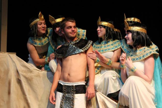"Joseph (Tom Palmer) is mobbed by adoring girls in ""Joseph & the Amazing Technicolor Dreamcoat"""