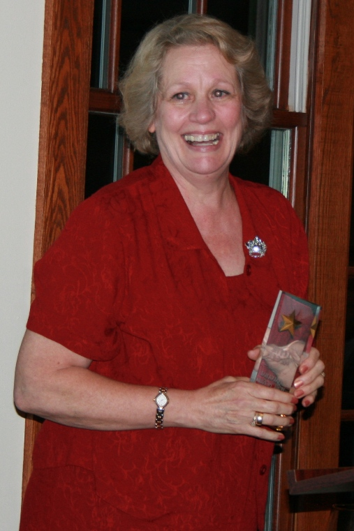 Dottie McGee accepting her induction into USP's Walk of Fame. Inducted in 2008, she was unable to be present to accept the honor because of her fight with cancer. She returned a year later and accepted the honor at the 2009 USP Award's Dinner.